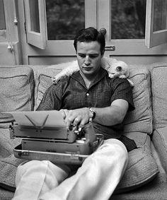 Marlon Brando and friend.  Real men like cats <3