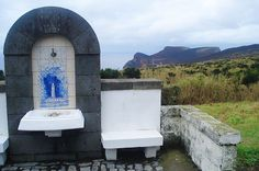 A historic fountain in the civil parish of Capelo, with an azulejo of the Capelinhos eruption, municipality of Horta (Azores), Portugal