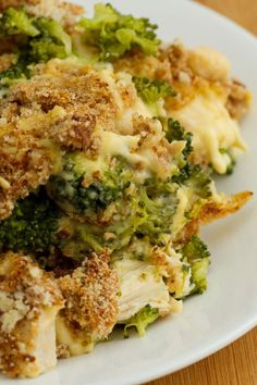 Chicken Divan Casserole Recipe - shredded chicken and broccoli in a creamy cheddar cheese sauce topped with bread crumbs and parmesan cheese.