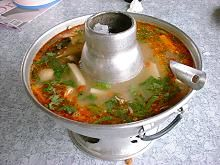 This is one example of a dinner in Thailand. This picture shows Tomyam Kung, a spicy lemongrass soup with shrimp.