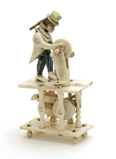 """carved by French prisoners of war in England circa 1820,polychromed figure stands at foot treadled powered wheel Size: 5"""" t."""