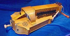"""The hurdy-gurdy or """"wheel fiddle"""" is an ancient stringed instrument from Europe. It operates by means of a hand-cranked wheel covered with pine resin which rubs over the strings (much like a violi… Hurdy Gurdy, Hammered Dulcimer, Musical Instruments, More Fun, Renaissance, Medieval, Musicals, Pilgrim, Guitars"""
