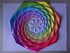 """Rainbow Spiral"" It's first time to challenge heptagon shapes.  Rainbow colors is the special feature of this Origami Mosaics. size:H330×W405mm 91 parts"