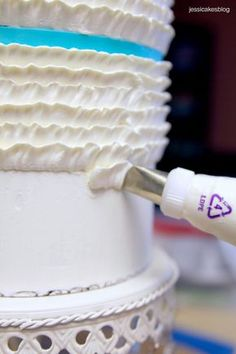Learn how to make beautiful buttercream ruffles (or buttercream frills) on your next cake project with my step by step pictures.