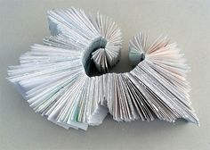 'Unrolling'  Sculptural form using drawings from life classes. 30x20 cms