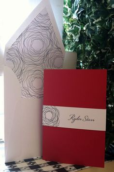 This Bat Mitzvah invitation was a red folder invitation with a paper wrap that held the additional inserts in place.  The wrap and liner were designed with the same floral design.