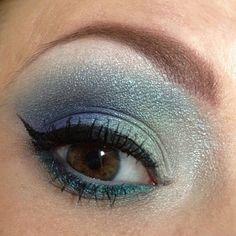 minty blues good with dark blue eyes? (: