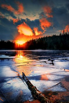 A fiery sunset over a frozen Ketchikan lake in Alaska.