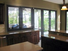 Folding doors connecting to a folding window to open up the inside kitchen to the outside kitchen. Folding Patio Doors, Your Space, Innovation, Windows, Luxury, Wall, Kitchen, Home, Cuisine