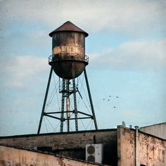 New York water towers 7 - 8x8 fine art photography print of an old water tower on a roof in Williamsburg, Brooklyn. $39.00, via Etsy.