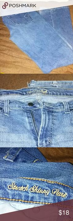 """American Eagle 12R jeans Super comfy 5 pocket American Eagle stretch skinny flare jeans..some fraying at bottom. Came that way. Super comfy jeans..31"""" inseam..17"""" waist 19"""" hips. American eagle  Jeans Flare & Wide Leg"""