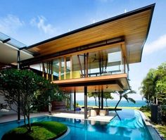 Modern tropical bungalow design by Guz Architects