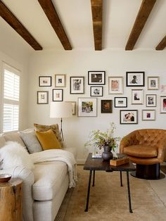 wood ceiling paneling, art on the walls and neutral texture and pattern mixing // living rooms