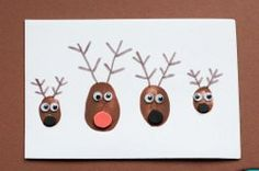 Cute Thumbprint Reindeer. Try making these Cute Thumbprint Reindeer for your Christmas card this year. These are really easy paper crafts to create with your family. The googly eyes make these brown painted reindeer even more adorable