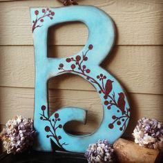 Blue and Brown Wooden Letter