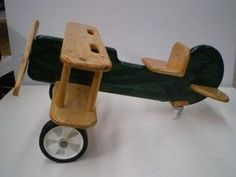 Wooden Bi-Plane Rocker and Bi-Plane push along in a choice of colours or make your own from our plans and patterns, Australian made and Australian designed. Wooden Ride On Toys, Wooden Plane, Making Wooden Toys, Wood Toys, Woodworking For Kids, Woodworking Toys, Woodworking Projects, Woodworking Machinery, Wood Games