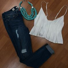 White crop top with jeans and a chunky necklace
