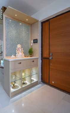 Prashanth Gupta's Duplex House Interiors - Bonito Designs Living Room Partition Design, Pooja Room Door Design, Foyer Design, Home Room Design, Temple Design For Home, Mandir Design, Hall Interior Design, Bungalow House Design, Pooja Rooms