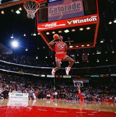 Michael Jordan leaps from the free-throw line for a perfect-score dunk in the 1988 NBA Slam Dunk Contest. A prolific dunker throughout his career due to his tremendous leaping ability, Jordan won back-to-back dunk contests in 1987 and