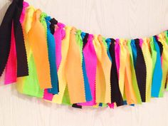 Glow in the Dark Party - Neon Fabric Tie Garland - Neon Bunting - Neon Party - Blacklight Party - 80s Party + 10% off Party Supplies Coupon by ThePartyTeacher on Etsy https://www.etsy.com/listing/252132373/glow-in-the-dark-party-neon-fabric-tie