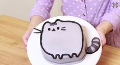 Set aside the notion that you've had too many sweets this holiday season and indulge in a cat-themed cake.