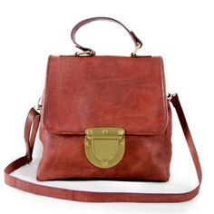Mini-satchel bag made in real leather  with maxi brass lock.  Completely handmade.