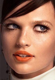 Long lashes and an orange pout // via Glamour Magazine