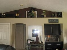 While you've just started to reflect on decorating ideas for plant shelves in living room for your own home, and primary on the list is your current living room… Vaulted Ceiling Living Room, Plant Shelves, Home Ceiling, Ceiling Shelves, High Shelf Decorating, Ledge Decor, Living Decor, Shelf Decor Living Room, Above Cabinets