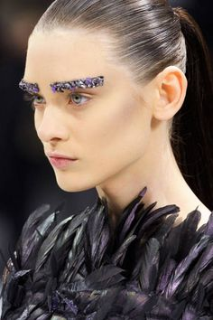 Trend: Bold Appliques  Fabric, paper, and metallic spikes appeared in unexpected places at Chanel (shown here), Miu Miu, Mugler, and Manish Arora.