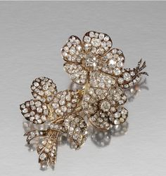 DIAMOND BROOCH, LATE 19TH CENTURY, Designed as a floral spray applied with two en tremblant flower heads, set throughout with circular-, rose-cut and cushion-shaped diamonds, later pin fitting.