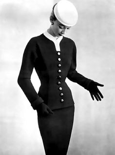 Sophie Malgat in Balenciaga, 1952. Photo: Philippe Pottier. I wonder if Givenchy had a good look at this suit; there are similarities between it and a suit he designed for Audrey Hepburn in Sabrina (1954).