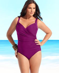 Showcasing graceful lines and sleek sophistication, this plus size swimsuit by Miraclesuit Sanibel whittles your middle and exudes a carefree attitude at the same time.  Nylon/spandex; drape: nylon/spandex  Hand wash  Imported  Look ten pounds lighter in ten seconds, thanks to Miraclesuit's flattering construction secrets  Supportive shoulder straps with ruched accents  Surplice V-neckline  Back scoop neckline  Hidden underwire support  Ruching at side  Allover body control  Full seat…