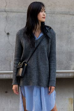 Here's how to update your summer shirt dress for the colder months – worn under a slouchy knitted V-neck with bare legs. #refinery29 http://www.refinery29.uk/2016/10/126995/street-style-seoul-fashion-week#slide-11