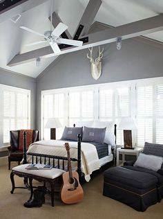 boy's rooms - Benjamin Moore - Storm - gray walls pale gray painted ceiling glossy black abacus poster bed blue linen glider nailhead trim storage ottoman leather wingback chair blue monogram pillows white modern nightstands
