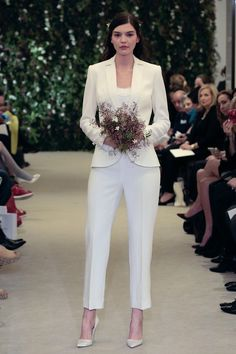 Bridal pants are the latest craze.A pantsuit from the Carolina Herrera bridal collection for spring Photo: Randy Brooke/Getty Images. Wedding Pantsuit, Wedding Suits, Bridal Looks, Bridal Style, Boyfriend Look, Vestidos Off White, Carolina Herrera Bridal, Bridal Dresses, Bridesmaid Dresses