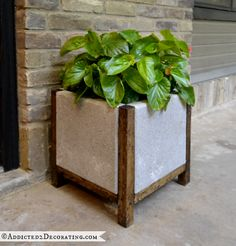 DIY Wood and Concrete Planter Easy DIY Wood and Concrete Planter: add a little concrete paint and this would go with any front door area.Easy DIY Wood and Concrete Planter: add a little concrete paint and this would go with any front door area. Concrete Pots, Concrete Crafts, Concrete Projects, Backyard Projects, Outdoor Projects, Garden Projects, Concrete Color, Concrete Blocks, Cement Pavers