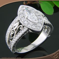 Love this Halo mounting with Marquise Diamond center stone and beautiful filigree work!