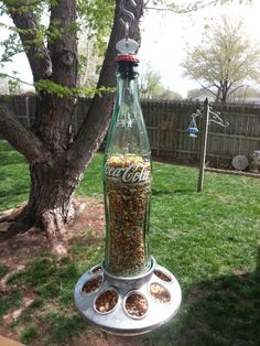 "14"" COKE POP BOTTLE BIRD FEEDER COCA-COLA 1 PINT GLASS/METAL HANDCRAFTED!  (I found this recycled glass bird feeder on eBay.)"
