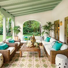 Spanish-Style Luxurious Loggia | Though this loggia is new, its Mediterranean tile and arches make it look original to the 1920s Spanish-style home. | SouthernLiving.com