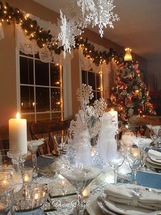 Dining Delight: Snowflakes & Snowmen - hanging snowflakes from the chandelier