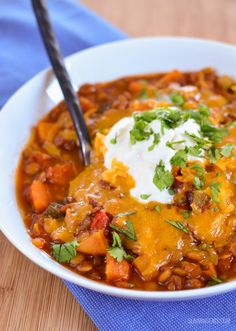 Warm yourself up with a comforting bowl of Sweet Potato, Vegetable and Lentil Chilli - budget friendly and can be cooked stove top or instant pot.