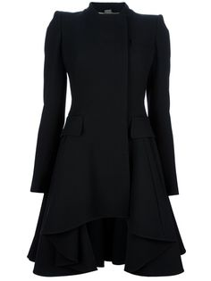 Alexander McQueen - flared coat Black silk-blend coat from Alexander McQueen featuring a round neck, a concealed front fastening, long sleeves with buttoned cuffs, flap pockets at the front, a ruffled skirt and a curved raised hem to the front. Black Wool Coat, Mein Style, Classy Outfits, Clothing Items, Alexander Mcqueen, Ideias Fashion, Style Me, Dresses For Work, Fashion Outfits