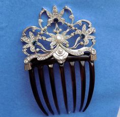 https://www.ebay.com/itm/Beautiful-Large-Hair-Comb-Ornament-with-Faux-Pearls-Paste-Stones/183138399595?hash=item2aa3e6356b:g:LLgAAOSwW3VasVKJ