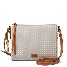 Whether you're hitting the town or the trails, carry your essentials with ease in our polka (heart) PVC crossbody. Get (tech) smart—this product is compatible with the iPad® mini.*Will be shipped separately from other products