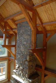 Timber frame trusses surround this stone masterpiece.