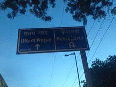 This board educates people where Uttam Nagar and Peeragarhi is.