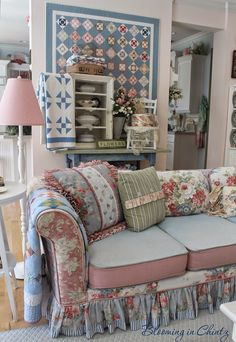 (Ideas for my living room...Floral print pillows with blue background, notice the little bit of blue & white stripe on bottom of ruffle. Touches of sage green will be pretty with blue and rose)