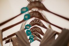 Bridesmaids hangers, I love that they're personalized AND they have something blue.