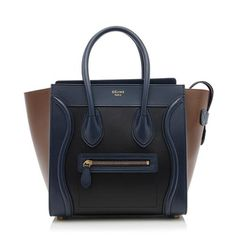 From the Fall 2015 Collection, this iconic Celine Micro Luggage tote is made from satin and palmelato calfskin in a black, navy blue, and brown colorway. Details include two rolled handles, antique gold-tone hardware, a front pocket, and zip closure. The interior is fully lined in navy blue lambskin with two open pockets and one zippered pocket.