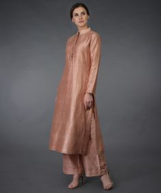 Classic chic pressed rose suit crafted in luxurious pure raw silk ( fabric can be customised to pure silk, pure crepe and pure georgette) . The kurta has a band collar neckline and inches long kurta patti front opening with decorative buttons Silk Kurti Designs, Kurta Designs Women, Kurti Designs Party Wear, Churidar Designs, Dress Indian Style, Indian Dresses, Indian Outfits, Pakistani Dresses, Indian Wear